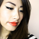 Winged Eyeliner and Bold Orange lips