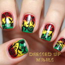 Freehand floral silhouettes over a rasta-color gradient