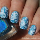 Blue holo and white roses nail art
