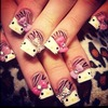 Hello Kitty nails.