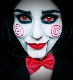 Wanna play a game..? 😈 Jigsaw makeup made with @mehronmakeup paradise paints in white, black and red; white transluscent power; @makeupgeekcosmetics eyeshadow in Corrupt; crazy lenses in Red Devil; wig from eBay.
