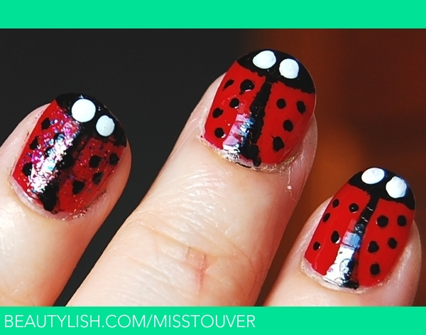 -I used: base coat, red, white, sparkly pink, nail art pen, top coat