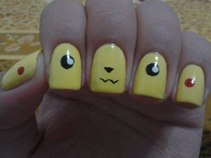 This nail design have been everywhere on the internet so I tried it out since it is soooo adorable! <3 I walked around my house and school showing everyone and going pika at them. Quite a fun nail design to rock!