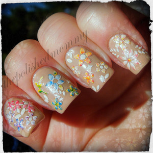 February Nail Art Challenge: Nude Polish. http://www.thepolishedmommy.com/2013/02/streaking-through-flowers.html  Flowers stickers available at bornprettystore.com and use the code NKL91 for 10% off your order and free shipping worldwide!