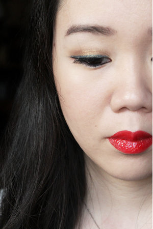 Red lips using the YSL Rouge Pur Couture Vernis À Lèvres Glossy Stain in 09 Rouge Laque  http://missmmayhem.blogspot.com/2015/06/the-red-lips.html