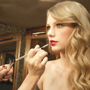 Taylor getting a red lip at her Wonderstruck commercial shoot.