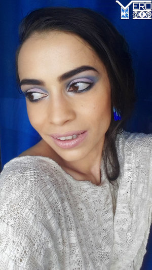 cut crease makeup style in shades of blue and lilac