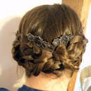 Simple romantic up do braid.