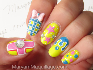 Hand-painted by me, inspired by Japanese Nail Art: http://www.maryammaquillage.com/2013/04/bright-textured-happy-3d-nail-art.html