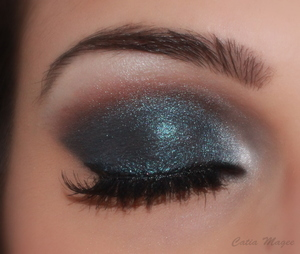 Pure Fusion Mineral Eyeshadows in Matte chocolate on the crease Matte black on the lid Nymph layered on top of the brown and black White Velvet on the brow bone and tear duct for highlight.
