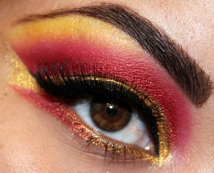 Inspired by the Sailor Moon villainess Sailor Galaxia  http://makeupbysiryn.com/2012/04/06/sailor-galaxia-inspired-look-beauty-blogger-collaboration-pt-2/