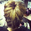 upside down plait with barrel bun