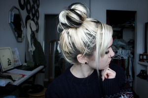 As promised, here is one type of bun i do. I'm not the greatest at it, but a friend on here requested a photo of it.  Pardon my roots and day 2 hair. :P