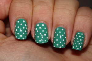 Base: Avon Peppermint Leaf - 2 coats Polka dots made with acrylic paints.  http://iloveprettycolours.blogspot.com/2011/11/31-day-challenge-day-eleven-polka-dots.html