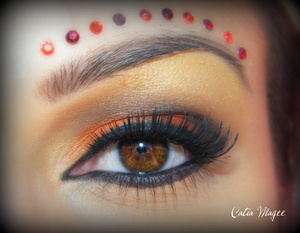 Indian Bride Using Pure Fusion Mineral Eyeshadows in Tequila Sunrise on the inner 2/3 of lid Crimson Kiss on the outer corner Matte Black on outer corner and crease Golden Gate on Brow highlight and tear duct.