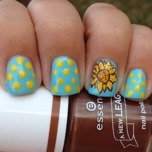 "For the ""yellow"" day of our challenge I decided to do a yellow sunflower and some dots.  Http://polishmeplease.wordpress.com"