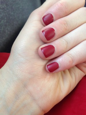 I got my nails painted matte red at a nail shop and I love them so much. They are a deep berry red colour and are awesome