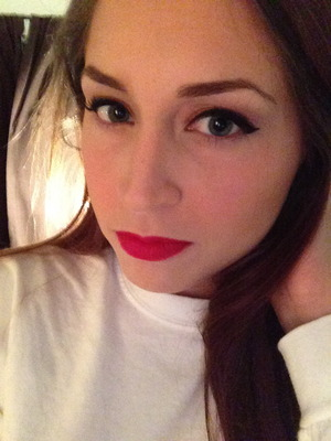 Black gel winged liner with bright red lips