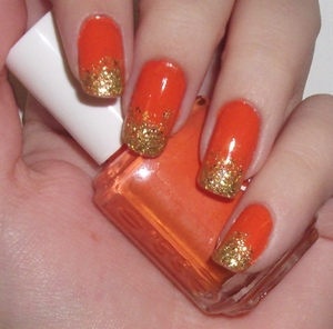 Essie Fear or Desire with gold glitter gradient tips using China Glaze Blonde Bombshell.