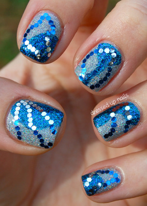 I use glitter all the time so to make my NYE nails extra-special I added glitter to the glitter!  http://www.dressedupnails.com/2013/01/my-new-years-eve-nails-wavy-blue-silver.html