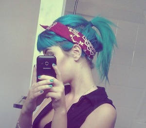 short cut bangs and high ponytail, teased under top sectionbefore pulled back and held together with a bandana.