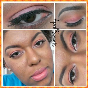 Light wash of orange in the crease and pink on the lid. Thin black liner. False lashes. Light pink lips.