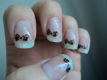 Acrylic white glitter tips with bow stamps