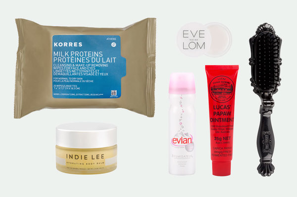 Our Staffers Never Fly without These Beauty Essentials