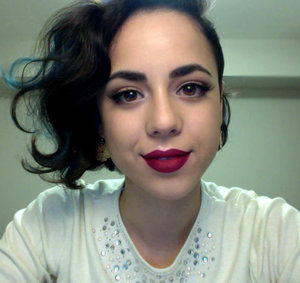 Simple eyes with a touch of dark purple paired with bold burgundy lips for fall.