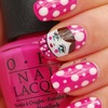 Hot pink polka dot nails with doll accent nail.