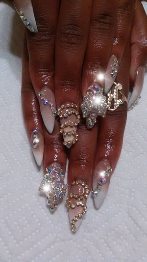 Beautiful ombre stiletto nails dripped in swarovski crystals