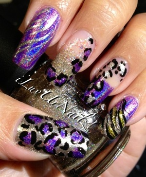 The colors I used to achieve this look are Jades Fascino Violeta, China Glazes I'm Not Lion & Snow Globe I also used Wet n Wilds Fergies Going Platinum I did some leopard prints with black acrylic paint 