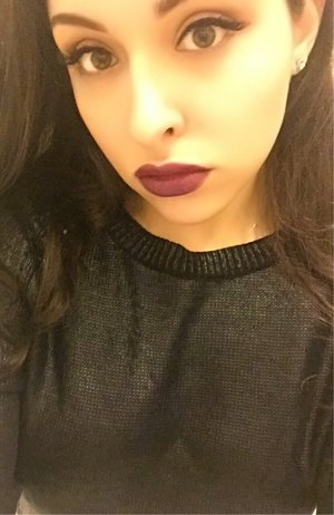 Purple lips, winged liner.