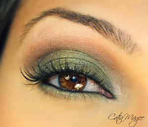 Date Night Look Matte medium brown on the crease Golden Olive green on the lid shimmery white color on the tear duct and as the brow highlight