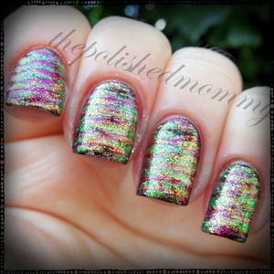 March Nail Art Challenge: Luck. http://www.thepolishedmommy.com/2013/03/lucky-stripes.html