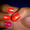 Glittery Neon Orange Mani with Pink Flower Accent Nail