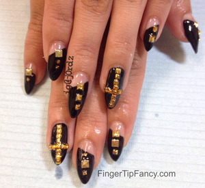 DETAILS HERE - http://fingertipfancy.com/black-nails-gold-studs