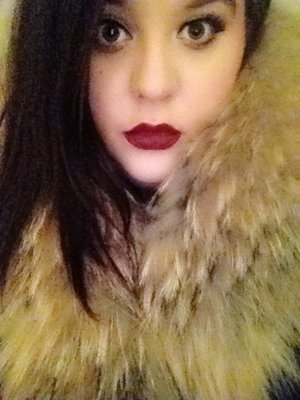 A bold lip and a fur collar. Holiday Winter Glam