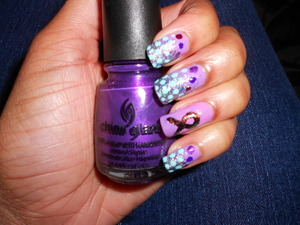 My dad was diagnosed with pancreatic cancer so i thought this design was rather appropriate . Base color is Essie/Playdate with China Glaze/ loreleis tiarra for the tip and Funky Fingers/ Mint for the dots and purple dots at the top. The i used a black nail art brush to do the ribbon and i put Essie/ Shine of The Times over it .
