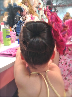 a ponytail split into a beautiful bun