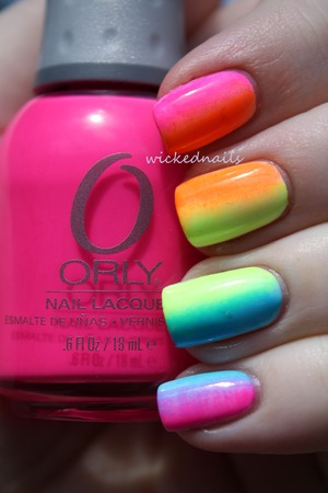 Rainbow Neon Gradient sponged on over white using wedge makeup sponge. Made popular on Instagram and Tumblr, this design was originally inspired by The Swatchaholic