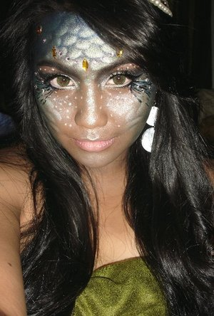 iv alrdy done a mermaid look before.. but wasnt that satisfied.. Disney movie's Atlantis inspired me to do the dark skin tone =D also i thought it would make shimer and rhinestones stand out more.