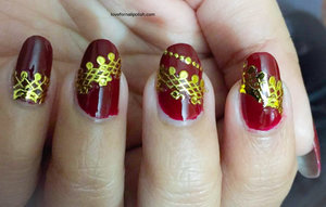 Detail Tutorial http://lovefornailpolish.com/stunning-dark-red-nail-design-with-gold-lace-tutorial-quick-and-easy-to-do