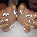 geometric handpainted design on acrylic stiletto