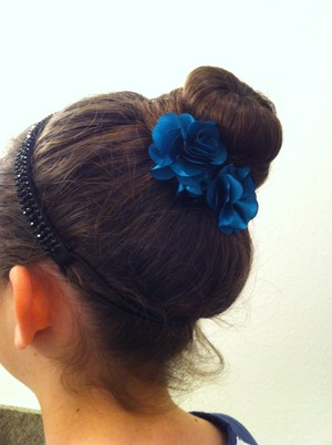 My friend Sophie did this bun in my hair and it was so easy and really cute:)
