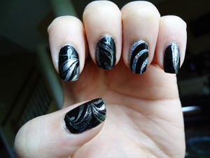 sorry for my dry cuticles! i painted all my nails black (except i glittered the ring fingers). then i marbled a silver glitter and clear top coat on the black nails and a black and clear top coat on the ring fingers.