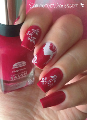 http://stampoholicsdiaries.com/2015/01/21/romantic-nails-with-sally-hansen-565-aria-red-y-and-marianne-nails-82/