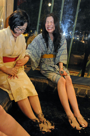 "Trying a ""Doctor Fish"" pedicure with my friend Hiroko in Tokyo."