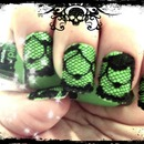 Green with black pattern and black-botton nail art