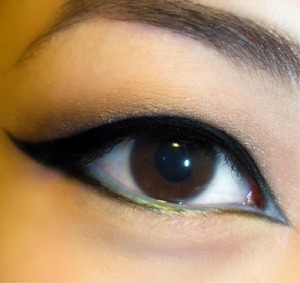 Heavy, heavy black liner on top of a smokey eye, with hints of blue shadow.